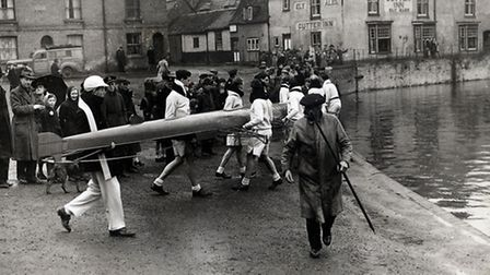 The Oxford University Boat Club prepare to launch on the River Great Ouse