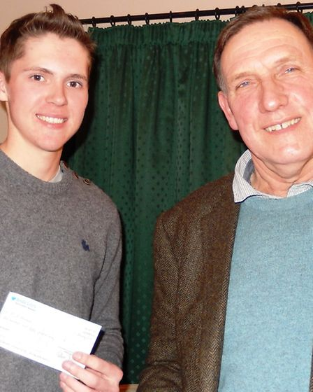 Jack Benstead receives a cheque for £150.