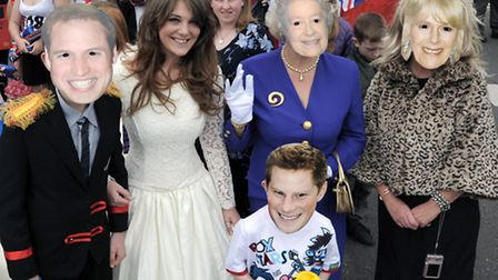 Members of Young People March dressed as the Royal Family for the March Summer Festival parade