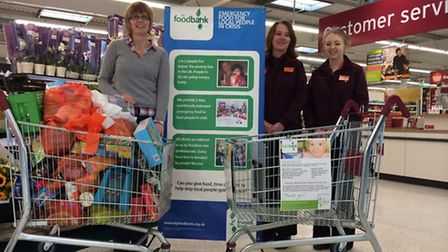Cathy Wright, Foodbank volunteer, with Amanda Clinton and Kerry Reynolds – from Sainsbury's.