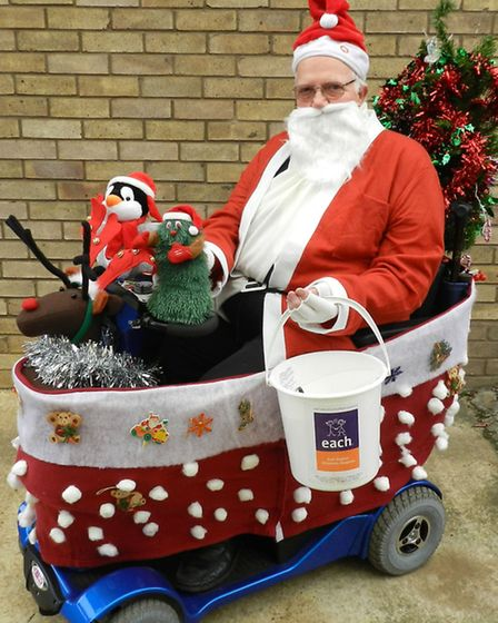 Stretham man Albert Tumber who has spent a lot of time decorating his mobility scooter ready for the