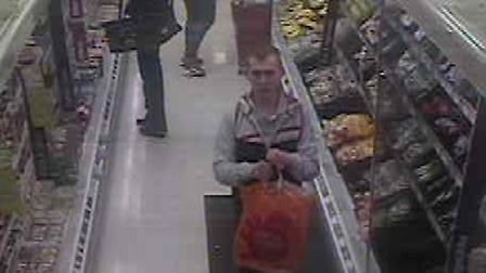 CCTV image of a man police wish to speak to.