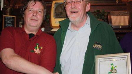 Elgood: Head brewer Alan Pateman accepting the gold award from Camra's Martin Ward, the festival org
