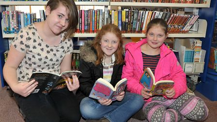 National Library Day, Chatteris Library. Left: Ciara Walsh, sisters Alice and Lucy Pealling.