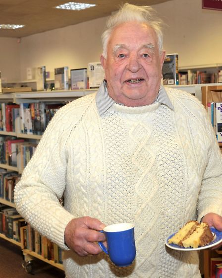 National Library Day, Chatteris Library. Cllr Terry Shad enjoying the free coffee and cake.