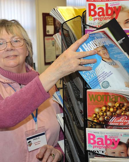 National Library Day, Chatteris Library. Margaret Allen with a magazine rack purchased by FROLIC.
