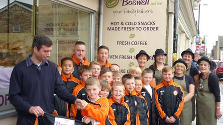 The youngsters are presented with their new jackets.