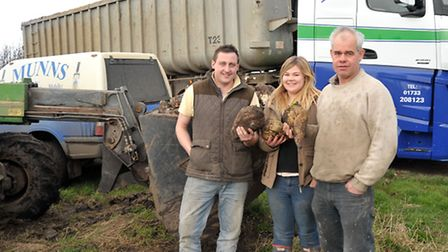 Farmer George Munns supplying suger beet for animal feed for Somerset floods. Left: Andrew Wagstaffe