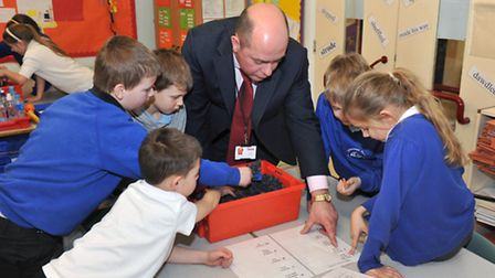 James Ellis leads a workshop with pupils about some of the items found at the site.