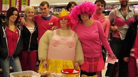 Staff at Central England Co-operative, Littleport, with cakes galore, wearing pink.