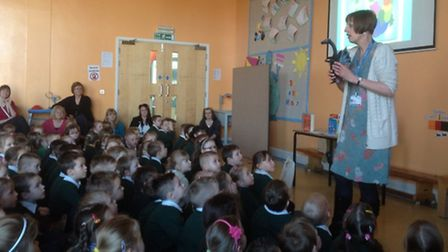 Louise Aldridge talks to Orchards children during an assembly.