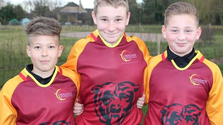 Dylan Rowlett, Connor Porter and Alfie Asher wearing the new shirts.