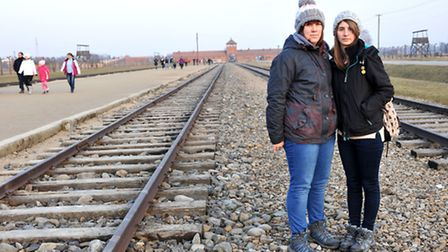 Ely College students Zoe Collins, left, and Kara Bailey on the tracks at Birkenau. Picture: Kath San