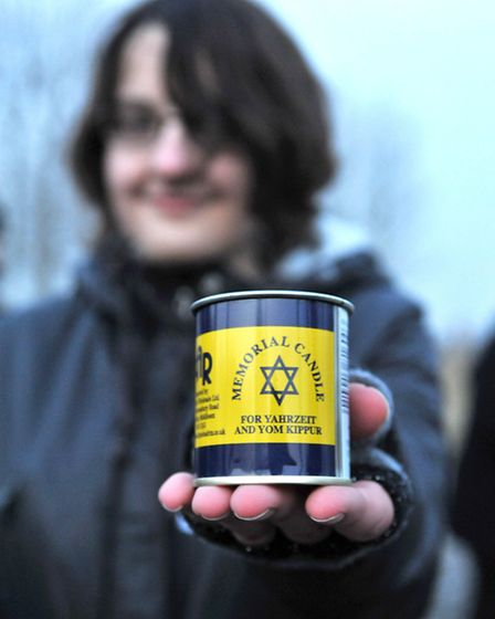 Lauren Mounfield with her memorial candle, which was lit at a memorial service held at the end of th