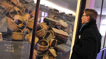Joel Fitzsimmons looking at suitcases and baskets that belonged to the prisoners. Picture: Kath Sans