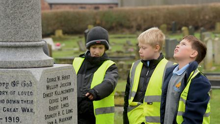 Harry, Ryan and Richard deep in their research at Emneth war memorial