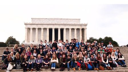 Students sit on the steps of the Lincoln Memorial in Washington DC.