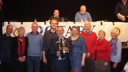 The Rotary Club of Dunmow president Richard Harris presents the trophy to Rose Bowl quiz winners, th