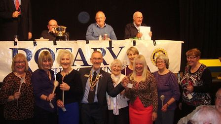 The Rotary Club of Dunmow president Richard Harris presents the wooden spoon to the Catholic Women's