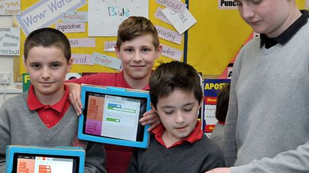 Enrichment day at Burrowmoor School, March. Left: Kallum, Robert and Ryan working on ipads with Neal