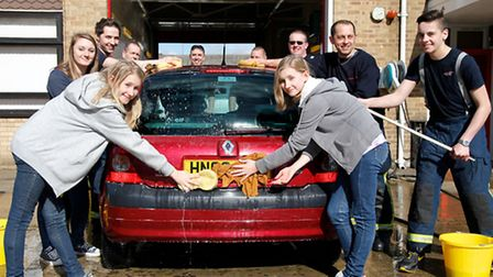 Getting down to the serious business as firefighters and supporters at Chatteris carry out a charity