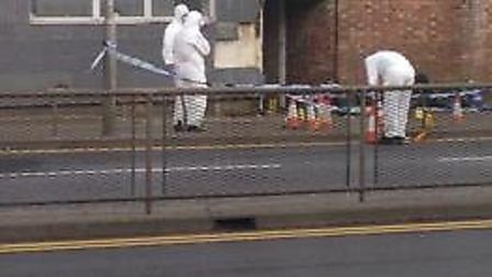 Forensics team in Wisbech at the scene of last night's stabbing