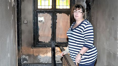 Arson attack on Wadyingstow House, Three Holes Wisbech. Owner Sara Ingram inspects the up stairs of