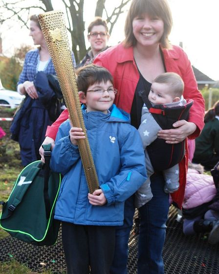 Miles Reynolds holding the Olympic torch