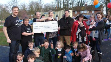 The Wilburton Beer Festival Committee hand over a cheque for £2,500