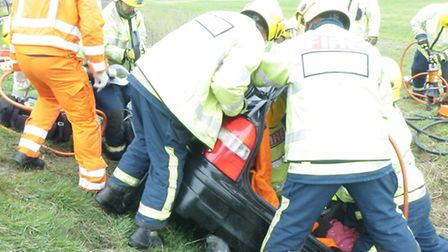 Rescue crews attempt to free the woman from the car.