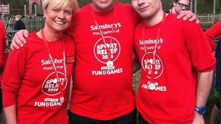 Sport Relief Mile runners Julie Wenn and Lewis Taylor with Sainsbury's chief executive Justin King.