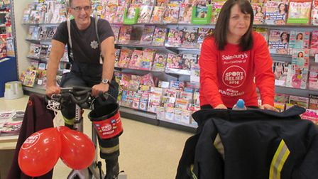 Rachel McCabe, of Sainsbury's cycling alongside a firefighter during Saturday's challenge.