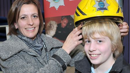 Careers convention at Neale Wade Academy, Teacher Amy Ellis with pupil Bryn trying on a firemans hel