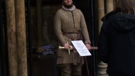 An actor outside Ely Cathedral