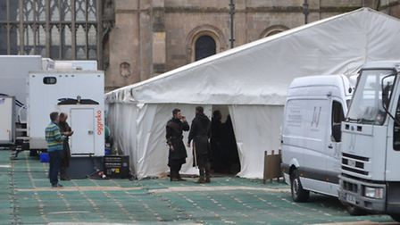 Extras for the filming of Macbeth take a break outside Ely Cathedral