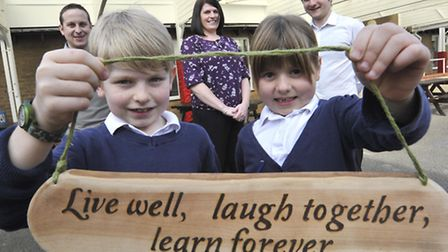 Sutton School Motto Winners (front l-r) Harry Simpson and sister Daisy Simpson, with (back l-r) dad