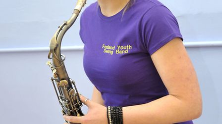 Rehearsals for Fenland Youth Swing Band. Lauren Young showing off the new polo shirt.
