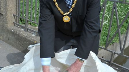 Whittlesey Mayor's charities fund raising Duck Race. Mayor of Whittlesey Dave Mason with the ducks r