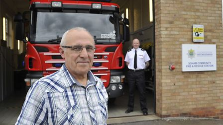 Soham Fireman (left) Mick Galley, retires after 29 years, with Watch Commander Richard Powell.