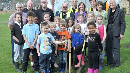 Children planting trees with help of Fenland Street Pride at Park Lane Primary and Nursery School Wh