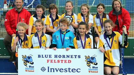 U12 girls: Back row from left, Marcus Hoare (coach), Clementine Dean, Eve MacLennan, Minty Latham (C