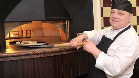 Frankie and Bennys opens in Wisbech. Chef Krzysztof Konachowicz working at the pizza oven. Picture: