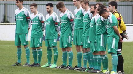 Soham players hold a minute's silence on Saturday