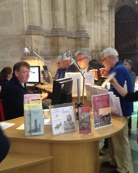 Visitors signs up for free passes at Ely Cathedral