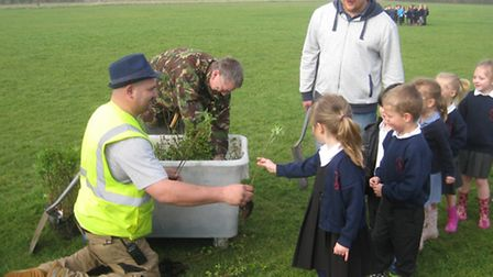 Pupils and parents get planting at Littleport Community Primary