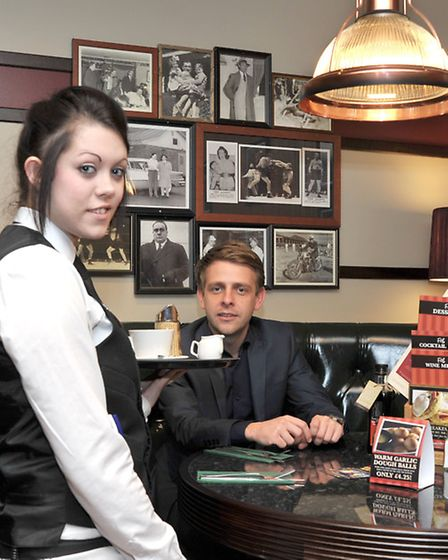 Frankie and Bennys opens in Wisbech. Left: Paige Holmes serves Gary Stevenson area support manager c