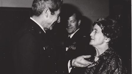 Doris Elsegood is presented with her USA Meritorious Civil Service medal by Major General Robert Baz