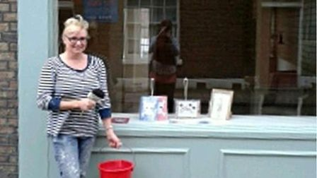 Jeni Townsend in front of her shop.