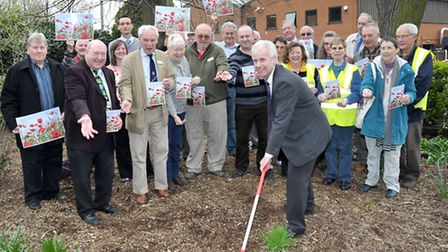 National Centenary Poppy Campaign. Bob Ollier Parks and Open Spaces Manager rakes the ground after c