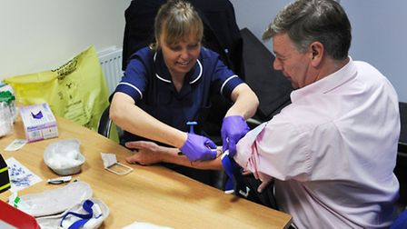 First in line for blood test at TB screening, Ian Smith, managing director of Erms. Picture: ROB MOR